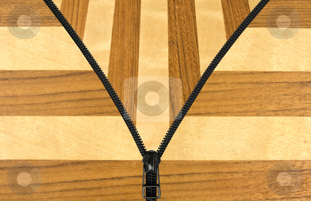 Zipped wood stock photo, Zipper opening to wooden background by John Teeter