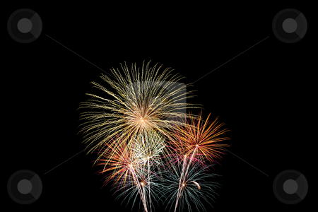 Multiple bursts of green, gold and purple fireworks stock photo, Multiple bursts of green, gold and purple fireworks light the night sky by Stephen Goodwin