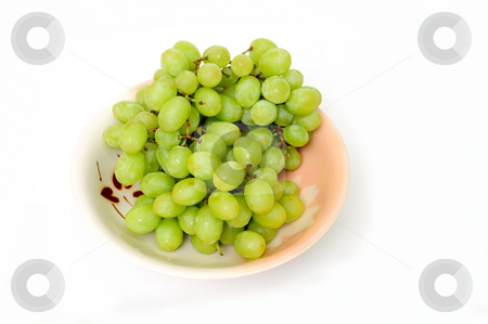 Green Grapes In A Bowl stock photo, Seedless grapes in a ceramic bowl  isolated on a white background by Lynn Bendickson