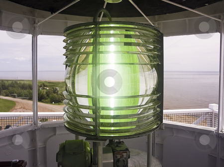 Fresnel Lens Shine from Lighthouse stock photo, Light shines through the fresnel lens atop the West Point LIghthouse, Prince Edward Island, Canada. by Kenneth Keifer