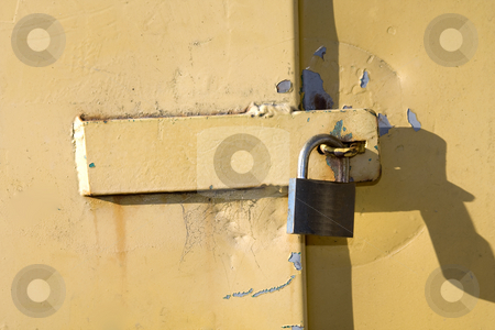 Yellow lock stock photo, Close up of padlock on a yellow door by Darren Pattterson