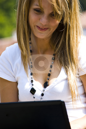 Beautiful young woman with laptop stock photo, Beautiful young woman working out with laptop or notebook by Desislava Dimitrova