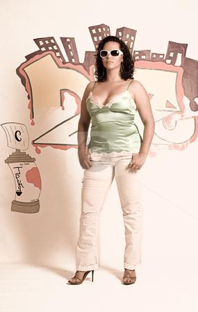 Latino women stock photo, Twenty something latino women standing in front of graffiti with white sunglass by Yann Poirier