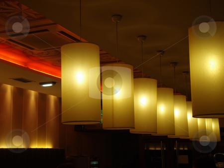 Row of lights stock photo, Row of lights in a coffe by Bernardo Varela