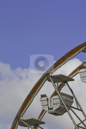 Ferris wheel car against a blue and white sky stock photo, Ferris wheel car against a blue sky with white clouds by Stephen Goodwin