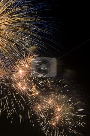 Firework stock photo, Firework display against black sky by Yann Poirier