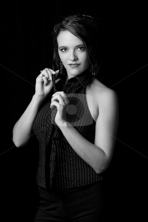 Business women undressing stock photo, Young and sexy business women undoing her tie by Yann Poirier