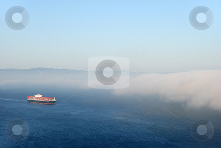 Tanker Entering Fog stock photo, A tanker carrying containers flowing into the fog. by Denis Radovanovic
