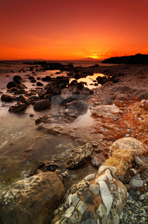 Rocky seascape sunset stock photo, Spectacular sunset over a dramatic rocky seascape in Mani peninsula, southern Greece by Andreas Karelias