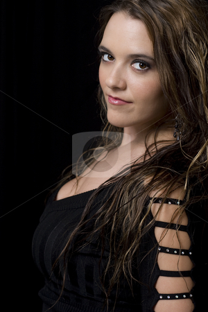 Young women stock photo, Portait of a women in her twenty looking over her shoulder by Yann Poirier