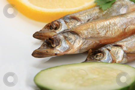 Smoked fishes with lemon, cucumber and green parsley. stock photo, Smoked fishes with lemon, cucumber and green parsley. Close-up. by Andrey Khritin