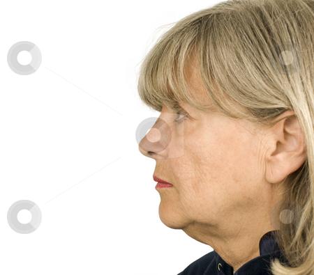 Senior Woman Profile stock photo, Senior woman profile on a white background by John Teeter