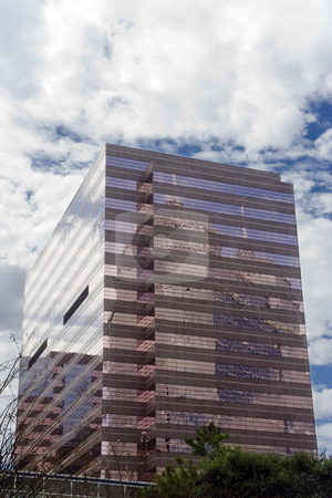 Pink Office Building stock photo, A pink office building with mirrored glass by Kevin Tietz