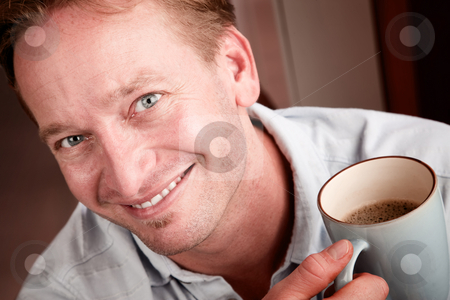 Handsome blonde man with coffee stock photo, Portrait of handsome blonde man with cup of coffee by Scott Griessel