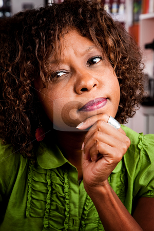 Perplexed young woman stock photo, Portrait of perplexed young African American woman by Scott Griessel