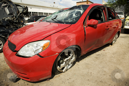 Car totaled in an accident stock photo, Dented results of an automotive accident by Scott Griessel