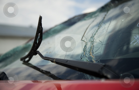 Broken windshield wiper on a broken car window stock photo, Broken windshield wiper on a cracked and broken car window by Scott Griessel