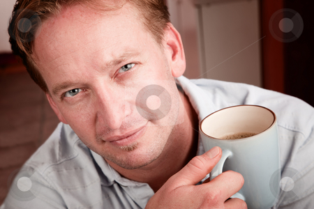 Handsome man with Coffee stock photo, Portrait of handsome man with coffee mug by Scott Griessel