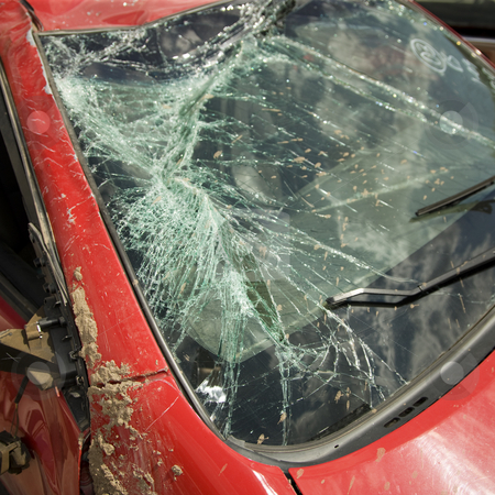 Broken window after car accident stock photo, Cracked window the result of a bad car accident by Scott Griessel