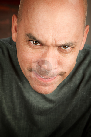 Angry Man stock photo, Angry man with mean expression and shaved head by Scott Griessel