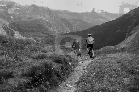 Mountain bikers stock photo, Two mountain bikers descending on a trail by ALESSANDRO TERMIGNONE