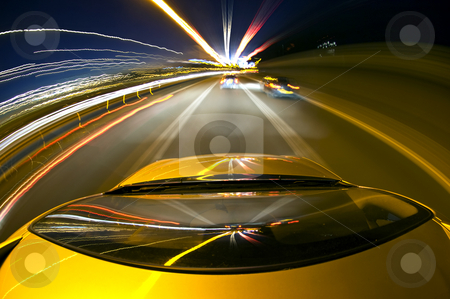 Overtaking stock photo, A car driving on a mortorway at high speeds, overtaking other cars by Corepics VOF