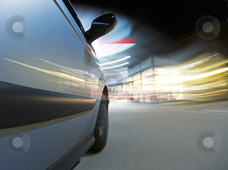 Getting Fuel stock photo, A car, running on empty, driving into a petrol station at night to get refueled by Corepics VOF