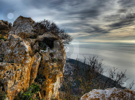 Rocks and sea stock photo, Looking towards  the Adriatic sea from a  high hiill somewhere on the island of Cres, Croatia. by Sinisa Botas