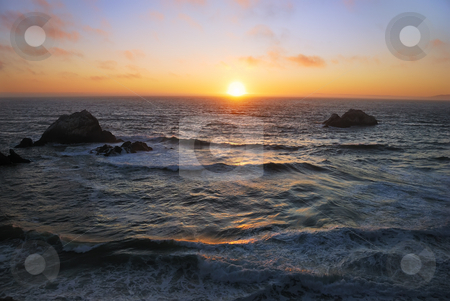 San Francisco Ocean Beach Sunset stock photo, Sunset above the wavy Pacific as seen from the Ocean Beach in San Francisco, California. by Denis Radovanovic