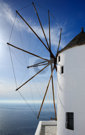 Windmill in Santorini stock photo, Image shows a large windmill, on the Greek island of Santorini, overlooking the Aegean Sea by Andreas Karelias