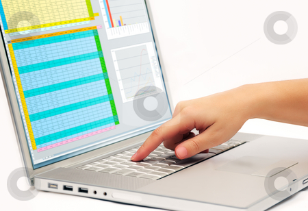 Pressing a laptop key stock photo, Image shows a finger pressing a key on a contemporary laptop  displaying a business spreadsheet by Andreas Karelias