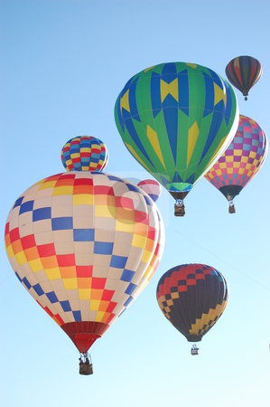 Hot air balloons rising into the sky stock photo, Group of colorful hot air balloons rising into the morning sky together. by Kevin Hooke