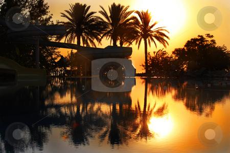Sunrise over swimming pool stock photo, Sunrise above swimming pool on Mediterranean seaside in summer resort in Turkey by Julija Sapic