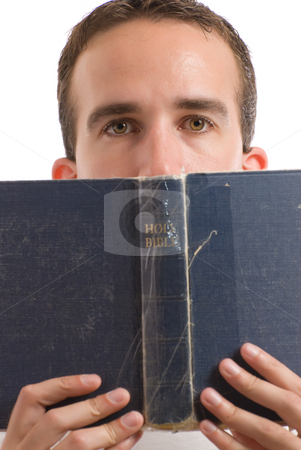 Holy Bible stock photo, A young man reading the Holy Bible, isolated against a white background by Richard Nelson