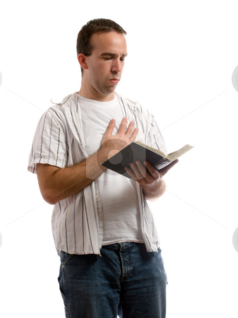 Prayer stock photo, A young man holding an old bible is saying a prayer, isolated against a white background by Richard Nelson