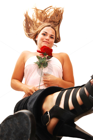 Pretty girl in pink lying on floor. stock photo, Young, lovely girl in a short pink dress with red hair, lying on the floor with a red rose, looking in the camera and lifting her legs, on white background by Horst Petzold