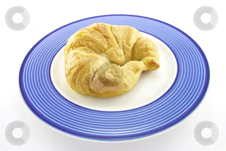 Croissant on a Plate stock photo, Single golden flakey delicious baked croissant on a blue plate on a white background by Keith Wilson