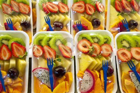 Packed fruit salad. stock photo, We can find these packed fruit salad on many stands inside the Boqueria Market, in Barcelona, Spain. by Anibal Trejo