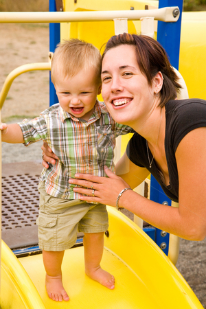 Cute Baby Boy and Mom stock photo, A portrait of a cute one year old baby boy at a park with his mom. by Travis Manley