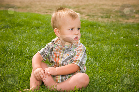 Cute Baby Boy stock photo, A portrait of a cute one year old baby boy at a park. by Travis Manley