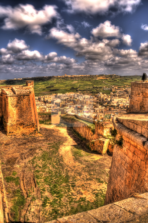 A Beautiful View of Rabat From Mdina In Gozo stock photo, This image is of a wonderful view of Rabat, a small town in Gozo in the Mediterranean sea. The image is taken from one of the many wall of the ancient city Mdina. by Stephen Kiernan