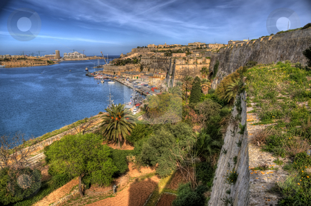 Overlooking Valetta Bay in Malta stock photo, This is a shot of Valetta Bay on the island of Malta. Water in the bay can be seen and there are small sea vessels to be seen. by Stephen Kiernan
