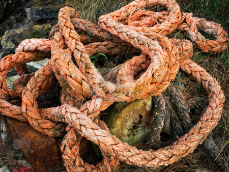 Rope stock photo, Old marine rope left on the seashore... by Sinisa Botas