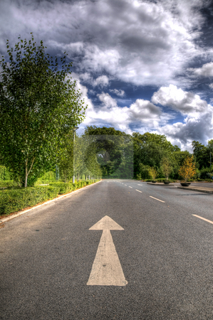 Arrow on the Road stock photo, An arrow on the ground pointing into the distance by Stephen Kiernan