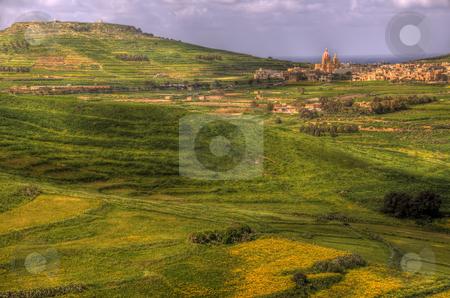 Green fields in Malta stock photo, A scenic view of fields on Gozo near the town of Rabat. by Stephen Kiernan