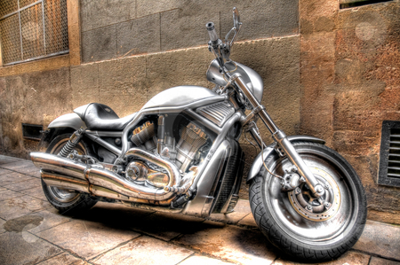 Motorbike on Street stock photo, A motorbike parked on the street in Barcelona by Stephen Kiernan