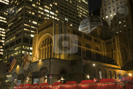 Saint Bartholomew's Episcopal Church New York City Nighttime Chr stock photo, Saint Bartholomew's Episcopal Church Park Avenue New York City  Completed in 1930.  At night with Christmas Fair.