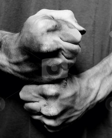 Two clenched male fists stock photo, Two clenched male fists  with right hand over left hand. by Sharon Arnoldi
