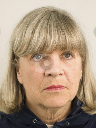 Depressed Senior Woman stock photo, Depressed senior woman facial portrait close up by John Teeter