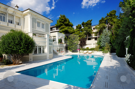 Luxury villa with swimming pool stock photo, Picture of a luxury villa with swimming pool by Andreas Karelias